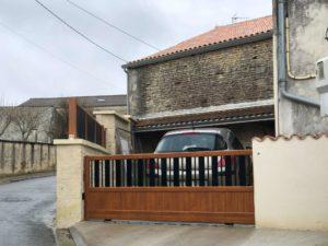 Portail Paso Doble couleur chêne doré à Asnières sur Nouère
